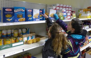 Stocking the shelves at the Bedford Food Pantry