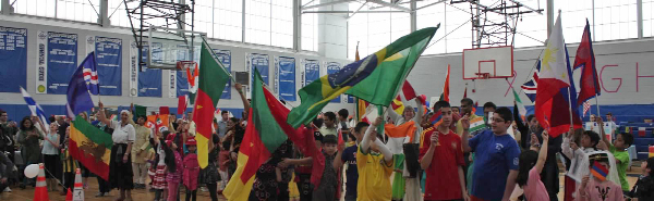 Flags of many nations waved proudly during the opening ceremony at Bedford's first Multicultual Festival - Image (c) _____,. 2015